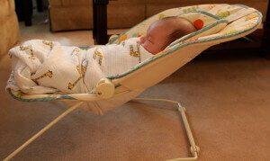 Baby in bouncing recliner seat