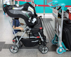 One way to carry the car seat in a sit-and-stand double stroller.